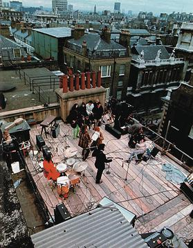 The Beatles performing on the roof of 3 Savile Row on 30th January 1969.
