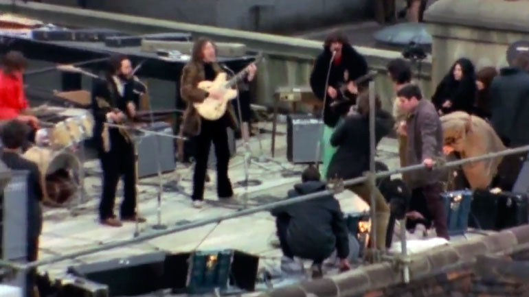 The Beatles performing on the roof of 3 Savile Row.